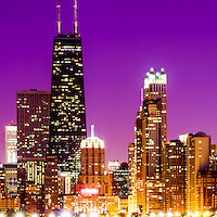 Purple Chicago skyline at night panorama photo. Includes the famous John Hancock Center skyscraper one of the tallest buildings in the world. Panoramic photo ratio is 1:3.