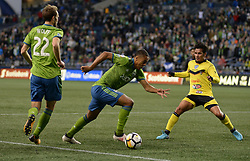 March 1, 2018 - Seattle, Washington, U.S - Soccer 2018: Sounder midfielder HENRY WINGO (23) works against ALDAIR RIVERA (25) in action as Santa Tecla FC visits the Seattle Sounders for a CONCACAF match at Century Link Field in Seattle, WA. Seattle won the match 4-0. (Credit Image: © Jeff Halstead via ZUMA Wire)