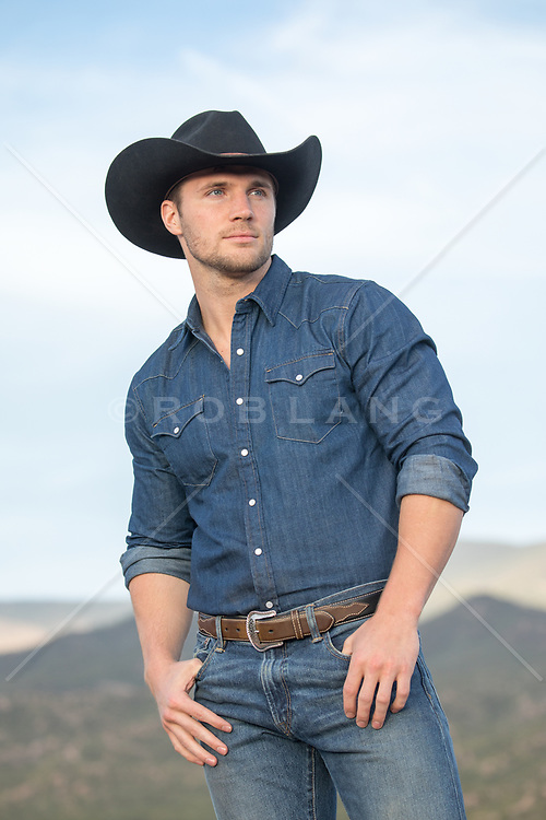 rugged and handsome cowboy outdoors