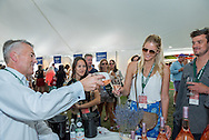 Tasting wine at a grand tasting at the Food & Wine Classic in Aspen.