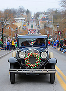 12/1/12 12:44:49 PM - Souderton, PA: .A classic car leads the way during the Souderton/Telford Holiday Parade December 1, 2012 in Souderton, Pennsylvania -- (Photo by William Thomas Cain/Cain Images)