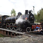 Staff use a turntable to turn the Kingston Flyer vintage steam train at Saturday's relaunch of the historic locomotives at Fairlight near Queenstown, Central Otago, New Zealand, 29th October 2011. Photo Tim Clayton...