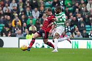 14th October 2017, Celtic Park, Glasgow, Scotland; Scottish Premiership football, Celtic versus Dundee; Dundee's Paul McGowan battles for the ball with Celtic's Olivier Ntcham