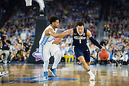 04 APR 2016: Guard Jalen Brunson (1) of Villanova University drives downcourt against Guard Joel Berry III (2) of the University of North Carolina during the 2016 NCAA Men's Division I Basketball Final Four Championship game held at NRG Stadium in Houston, TX. Villanova defeated North Carolina 77-74 to win the national title. Brett Wilhelm/NCAA Photos