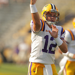 LSU redshirt freshman quarterback, Jarett Lee (12) throws a pass during pregame warm-ups, Lee shared snaps with junior quarterback Andrew Hatch in the team's season opener against Appalachian State. The LSU Tigers defeated the Appalachian State Mountaineers 41-13 at Tiger Stadium in Baton Rouge, LA.
