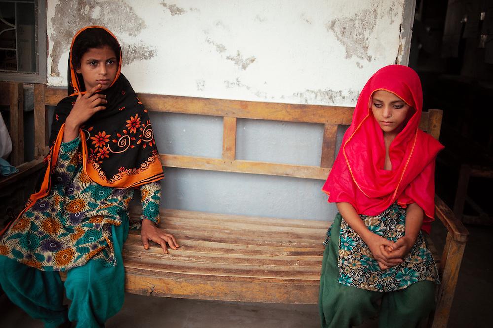 Children wait for their mothers in the government health clinic, Barrat Khan Lagar, Dadu, Sindh, Pakistan on July 5, 2011.