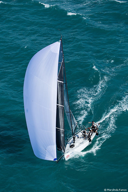 Aerial view of helmsman Jason Carroll, tactician Cameron Appleton, and crew Anthony Kouton, Scott Norris, Weston Barlow, Graham Landy, Philip Wehrmeim, and Mike Kuschner flying downwind en route to winning the 2014 Melges 32 World Championship.  This was Argo's 2nd consecutive win, a first in class.