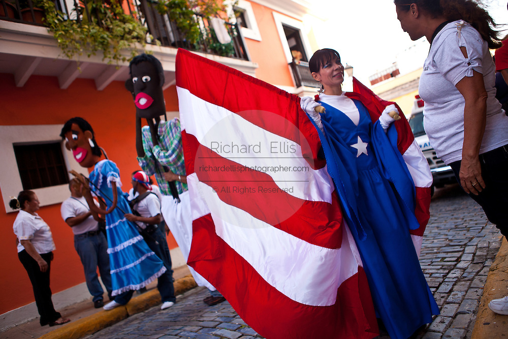 Costumed revelers parade during the Festival of San Sebastian in San Juan, Puerto Rico.