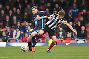 Bury FC midfileder Danny Mayor  and Grimsby Town midfielder Jake Hessenthaler(7) during the EFL Sky Bet League 2 match between Grimsby Town FC and Bury at Blundell Park, Grimsby, United Kingdom on 23 March 2019.