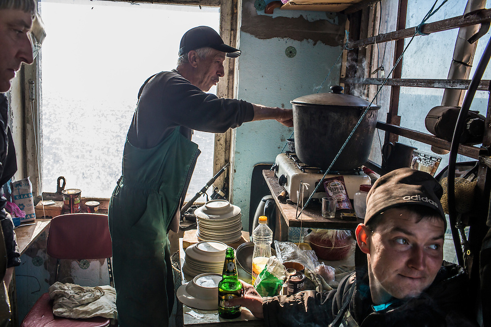 A fisherman cooks ukha, a traditional Russian fish soup, on Saturday, April 11, 2015 in Siedove, Ukraine.