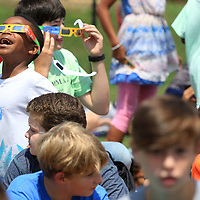 Dillon Washington, 11, a sixth grader at Mooreville Middle School, gets his first look at the 2017 Solar Eclipse on Monday afternoon. The Mooreville Middle School students went to the baseball field to view the event.