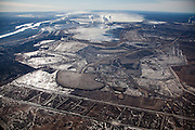Tar sands mines and facilities in Alberta are among the largest industrial activities on Earth. The Syncrude Mildred Lake mine, on the banks of the Athabasca River (upper left), measures more than ten miles across.