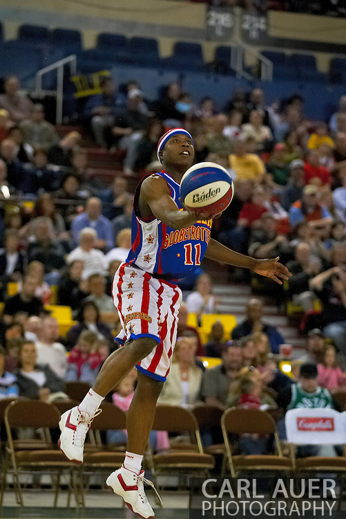 04 May 2006: Keiron 'Sweet P' Shine tosses up a lob during the Harlem Globetrotters vs the New York Nationals at the Sulivan Arena in Anchorage Alaska during their 80th Anniversary World Tour.  This is the first time in 10 years that the Trotters have visited Alaska.