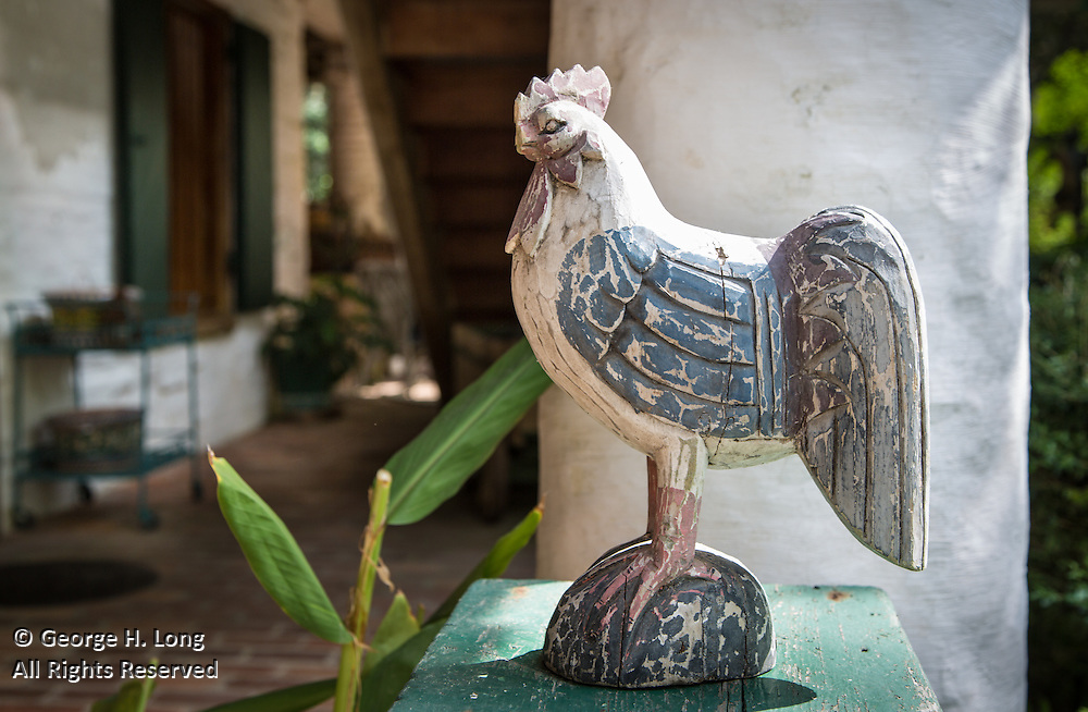 Carved, wooden rooster on display outside Parlange Plantation in New Roads, Louisiana