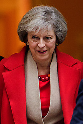 © Licensed to London News Pictures. 12/12/2016. London, UK. British prime minister THERESA MAY seen leaving 10 Downing Street in London on December 12, 2016. The PM's office has been reported to have had a text message altercation with former education secretary Nicky Morgan.. Photo credit: Ben Cawthra/LNP