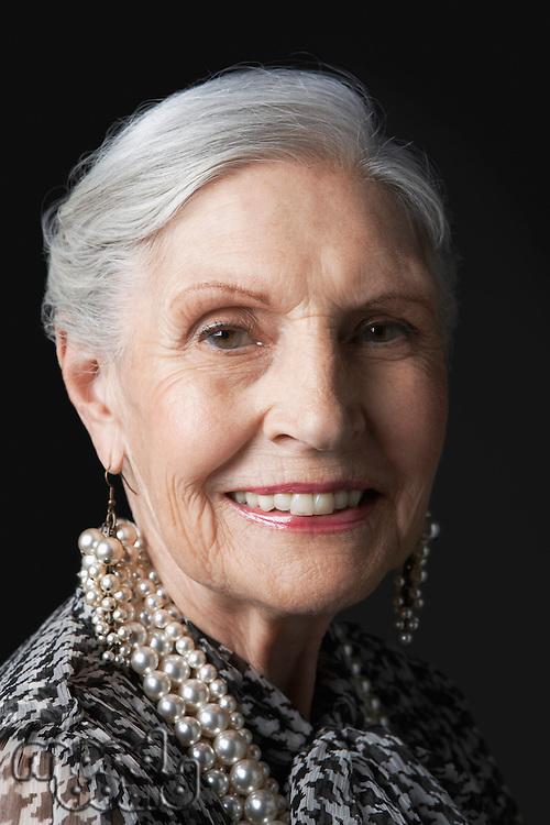Senior Woman with Pearl Earrings