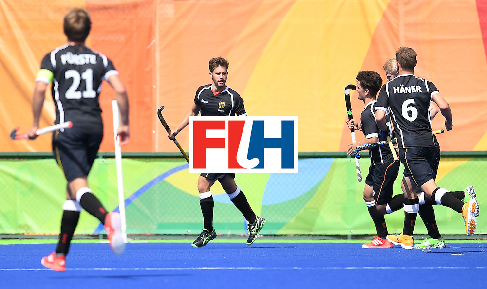 Germany's Timm Herzbruch (C) celebrates scoring a goal during the men's field hockey Argentina vs Germany match of the Rio 2016 Olympics Games at the Olympic Hockey Centre in Rio de Janeiro on August, 11 2016. / AFP / MANAN VATSYAYANA        (Photo credit should read MANAN VATSYAYANA/AFP/Getty Images)