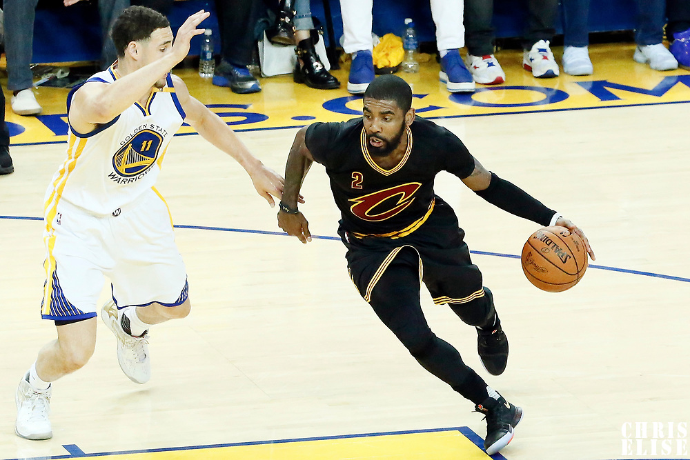 12 June 2017: Cleveland Cavaliers guard Kyrie Irving (2) drives past Golden State Warriors guard Klay Thompson (11) during the Golden State Warriors 129-120 victory over the Cleveland Cavaliers, in game 5 of the 2017 NBA Finals, at the Oracle Arena, Oakland, California, USA.