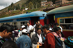 Passengers get off the train at Huancavelica Station. The 128 km normally takes five to six hours to complete in normal weather. During the rainy season, January to March, it usually takes much longer due to landslides.