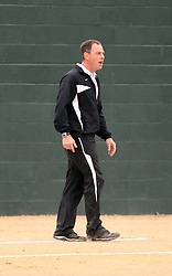 30 March 2013:  Titan Head Coach Steve King during an NCAA Division III women's softball game between the DePauw Tigers and the Illinois Wesleyan Titans in Bloomington IL