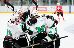 Players of Olimpija celebrate after scoring 3rd goal during Ice hockey match between HDD SIJ Acroni Jesenice and HDD Telemach Olimpija in Main Round of Slovenian National Championship 2014/15, on October 28, 2014 in Arena Podmezakla, Jesenice, Slovenia. Photo by Vid Ponikvar / Sportida