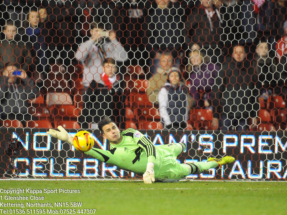FOREST KEEPER KARL DARLOW DIVES THE RIGHT WAY TO SAVE LEICESTERS KEVIN PHILLIPS PENALTY SHOT, Nottingham Forest v Leicester City, City Ground Nottingham,  Sky Bet Championship, 19th Febuary 2014