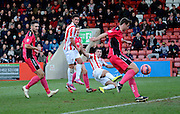 Terry Gornell shoots during the The FA Cup match between Cheltenham Town and Dover Athletic at Whaddon Road, Cheltenham, England on 7 December 2014.