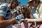 Alberto Contador took time to sign autographs before the start of stage 6.