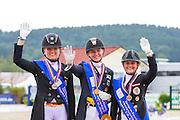 Podium U25 Freestyle 1. Janneke Rothenberger - Deveraux OLD, 2. Florine Kienbaum - Doktor Schiwago 3, 3. Diana Porsche - Di Sandro<br /> European Championships Dressage U25 2016<br /> © DigiShots