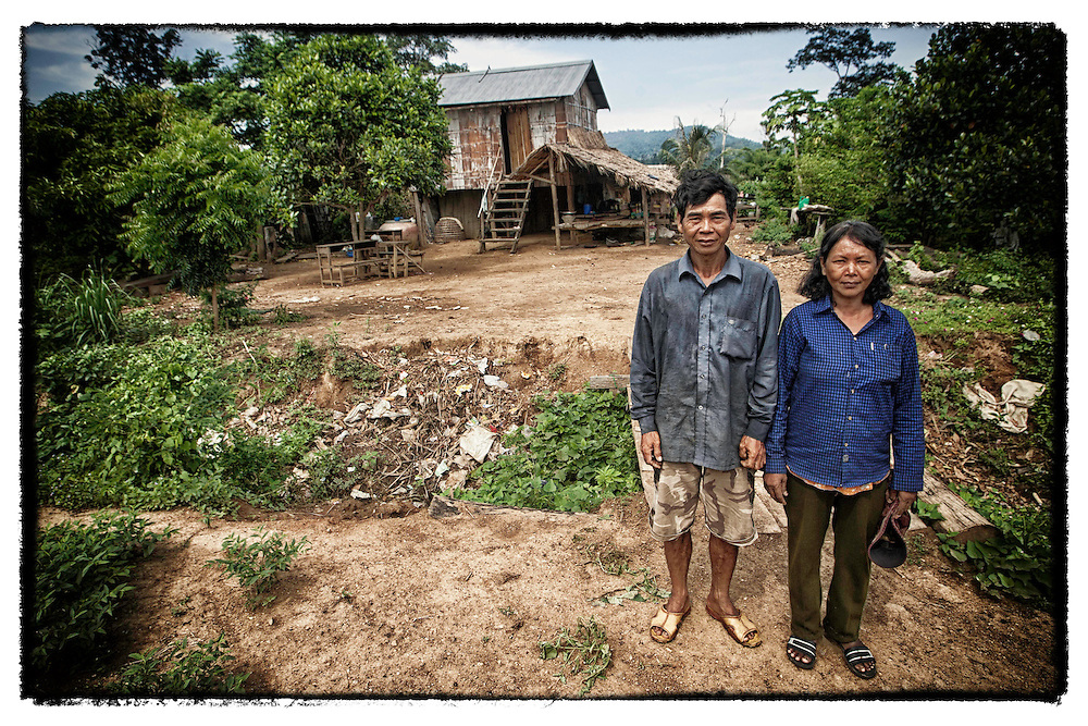 A Cambodia couple near their home along the  border with Thailand