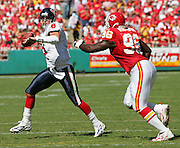 KANSAS CITY, MO - SEPTEMBER 26:  Quarterback David Carr #8 of the Houston Texans rolls right looking for a receiver while being chased by defensive end Jimmy Wilkerson #96 of the Kansas City Chiefs at Arrowhead Stadium on September 26, 2004 in Kansas City, Missouri. The Texans defeated the Chiefs 24-21. ©Paul Anthony Spinelli *** Local Caption *** David Carr, Jimmy Wilkerson
