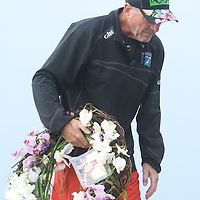 Ed Pierce carries a wreath Sunday August 3, 2014 to remember his wife Barbara Pierce at the former quarantine station where she lost her life in a boating accident two years ago. (Jason A. Frizzelle)