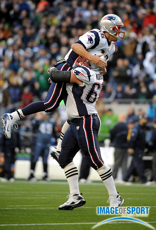 Dec 7, 2008; Seattle, WA, USA; New England Patriots quarterback Matt Cassell (16) jumps into the arms of center Dan Koppen (67) after converting a two-point conversion in the fourth quarter against the Seattle Seahawks at Qwest Field. The Patriots defeated the Seahawks 24-21.
