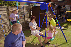 Family playing together in back garden,