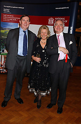 LORD IRVINE OF LAIRG and SIR TIMOTHY & LADY CLIFFORD at a reception hosted by Brian Ivory Chairman of the Trustees of The National Galleries of Scotland to commemorate Sir Timothy Clifford's 21 years of Director of the National Gallery of Scotland and his forthcoming retirement in January 2006, held at Christie's, King Street, London W1 on 6th December 2005.<br />