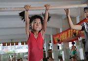 NANNING, CHINA - JUNE 17: (CHINA OUT) <br /> <br /> Gymnastics Children In Nanning<br /> <br /> Children aged 4 to 13 take part in a gymnastics training session at Nanning Sports School on June 17, 2013 in Nanning, Guangxi Province of China.<br /> ©Exclusivepix