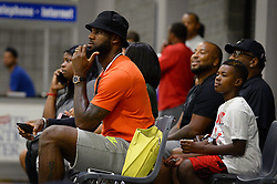 July 21, 2017 - Charlotte, NC, USA - NBA star LeBron James sits along court side watching his son, LeBron Jr., and his teammates compete in a youth tournament at the Charlotte Convention Center in Charlotte, N.C., on Friday, July 21, 2017. (Credit Image: © Jeff Siner/TNS via ZUMA Wire)