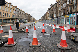 Edinburgh, Scotland, UK. 21 June, 2020. Traffic management work and lane closures on Leith Walk signals the start of construction work for the new Edinburgh tram line extension to Newhaven. Disruption to traffic and businesses on Leith Walk is expected to last for over a year. Iain Masterton/Alamy Live News