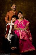 Jun 19, 2011; San Antonio, TX, USA; Studio portrait of family with son smiling.  Photo by San Antonio Wedding & Portrait Photographer Soobum Im.