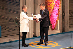 OSLO, Dec. 10, 2016 (Xinhua) -- Colombian President Juan Manuel Santos (R) receives the medal and diploma from Berit Reiss-Andersen, deputy chair of the Norwegian Nobel  at an awarding ceremony in Oslo, Norway, Dec. 10, 2016. Juan Manuel Santos received the 2016 Nobel Peace Prize on Saturday for his efforts to bring his country's five-decade-long civil war to an end. (Xinhua/Zhang Shuhui) (sxk) (Credit Image: © Zhang Shuhui/Xinhua via ZUMA Wire)