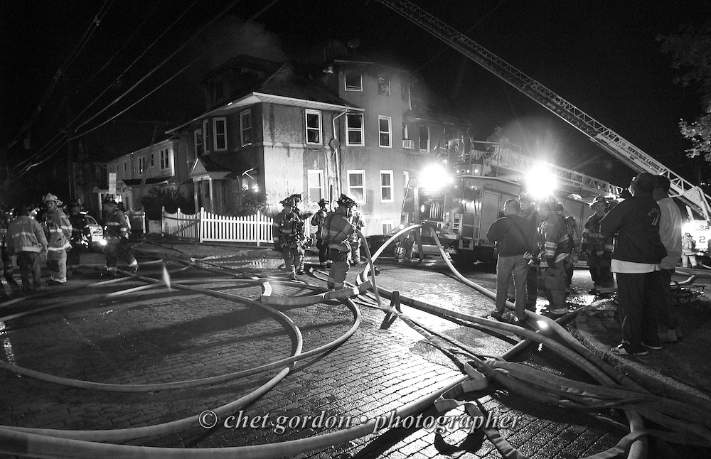 Newburgh firefighters on the scene of a three-alarm fire at 488 Liberty Street in Newburgh, NY on Sunday, October 23, 2011. Nearly a dozen people were left homeless after the fire erupted in the multi-family home when a resident was cooking in a second-floor apartment in the rear of the building. All the occupants got out safely and there were no injuries.  CHET GORDON/Times Herald-Record