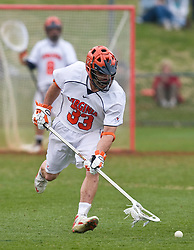 Virginia Cavaliers D Matt Kelly (33) scoops up a loose ball against UMD.  The #9 ranked Maryland Terrapins fell to the #1 ranked Virginia Cavaliers 10 in 7 overtimes in Men's NCAA Lacrosse at Klockner Stadium on the Grounds of the University of Virginia in Charlottesville, VA on March 28, 2009.