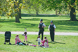 ©Licensed to London News Pictures 15/04/2020  <br /> Greenwich, UK. Police on patrol talking to people having a picnic in Greenwich park, Greenwich, London as people get out of the house from coronavirus lockdown to exercise for an hour. Photo credit:Grant Falvey/LNP