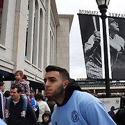 New York City FC fans arriving at Yankee Stadium passing Babe Ruth Plaza before the New York City FC v New England Revolution, Inaugural MSL football match at Yankee Stadium, The Bronx, New York,  USA. 15th March 2015. Photo Tim Clayton