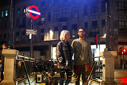 © Licensed to London News Pictures. 20/08/2016. London, UK. Tube passengers leave Oxford Circus station in London after using the night tube services for the first time on 20 August 2016. Transport for London started a 24-hour Tube service on Victoria and Central lines as demand has soared over recent years, with passenger numbers on Friday and Saturday nights up by around 70 per cent since 2000. The plan was announced in November 2013 and intended to begin in September 2015, but strikes over pay delayed the start by nearly another year. Photo credit: Tolga Akmen/LNP