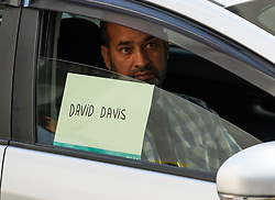 © Licensed to London News Pictures. 09/07/2018. London, UK. A taxi used as a diversion, with the name David Davis written in the window, waits outside BBC Broadcasting House in London after the resignation of David Davis over Prime Minister Theresa May's Brexit Plan. Mr Davis was appointed to the post in 2016 and was responsible for negotiating the UK's EU withdrawal. Photo credit: Ben Cawthra/LNP