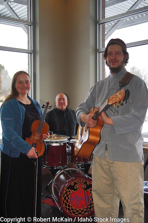 IDAHO. Boise. Jewish folk musicians at Bat Mitzvah celebration. December 2008. #pa080747 MR