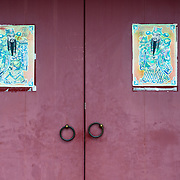 Common household door gods 'Jinlu'  and 'Jiaguan' hold a deer and cap, symbolizing good fortune and promotion respectively. , Da Guanyin Ting, Tainan City, Taiwan