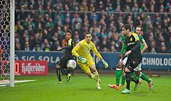 08.02.2014, Weserstadion, Bremen, GER, 1. FBL, SV Werder Bremen vs Borussia Dortmund, 20. Runde, im Bild Pierre-Emerick Aubameyang (BVB Borussia Dortmund #17) koepft umber Raphael Wolf (SV Werder Bremen #20), die Mitte, Henrikh Mkhitaryan (BVB Borussia Dortmund #10) kann den Ball jedoch nicht im Tor unterbringen // Pierre-Emerick Aubameyang (BVB Borussia Dortmund #17) koepft umber Raphael Wolf (SV Werder Bremen #20), die Mitte, Henrikh Mkhitaryan (BVB Borussia Dortmund #10) kann den Ball jedoch nicht im Tor unterbringen during the German Bundesliga 20th round match between SV Werder Bremen and Borussia Dortmund at the Weserstadion in Bremen, Germany on 2014/02/08. EXPA Pictures © 2014, PhotoCredit: EXPA/ Andreas Gumz<br /> <br /> *****ATTENTION - OUT of GER*****