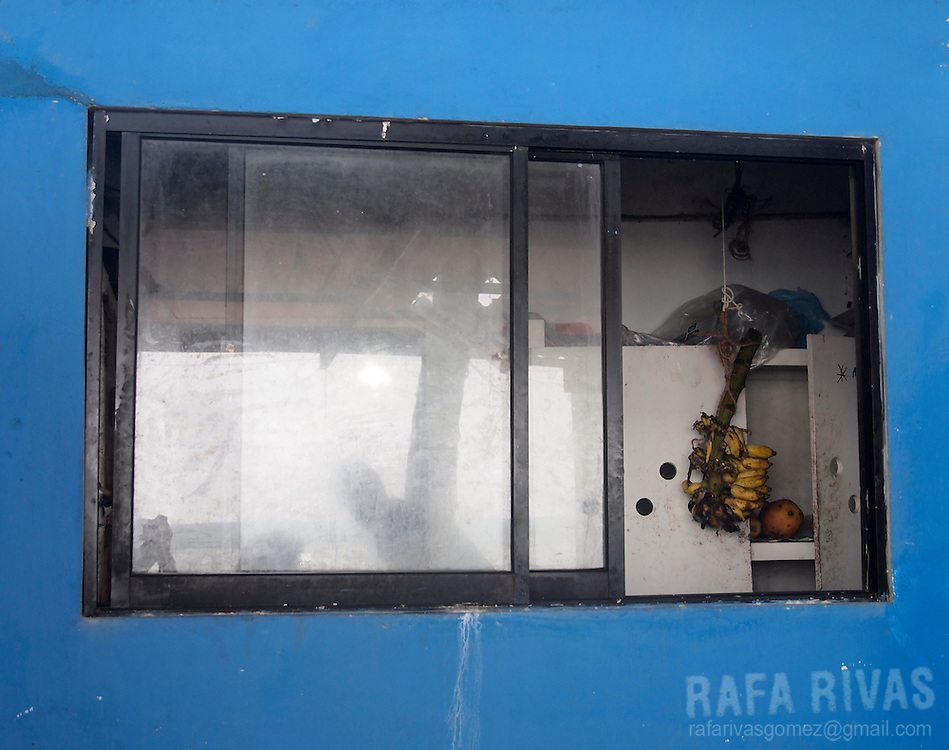 Some bananas are seen through a restaurant window in Hikkaduwa, Sri Lanka, on February 26, 2011.